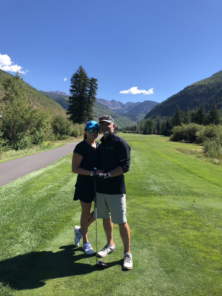 Mike and Megan playing golf in Vail, Colorado