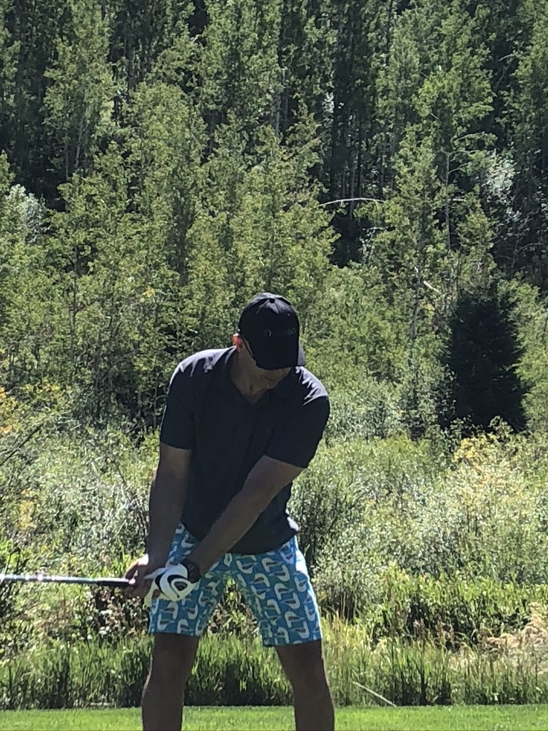 Patrick Brown playing golf in Vail, Colorado