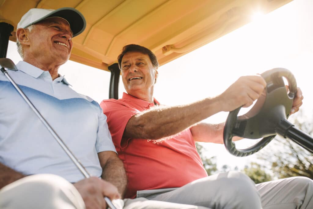 Two guys playing golf